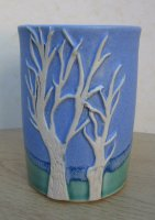 Blue vase with two carved trees